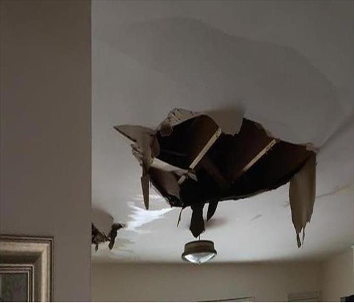 Water Damaged Roof Affects Several Different Rooms in Arlington Before